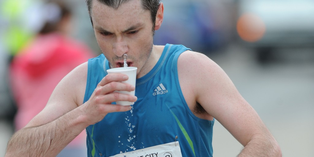 Marathon runners struggle to drink from plastic cups