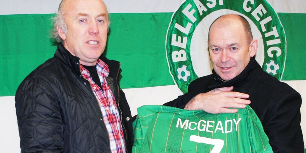 Aiden McGeady's father John (right) and his uncle Pat donate Aiden's Ireland jersey to the museum