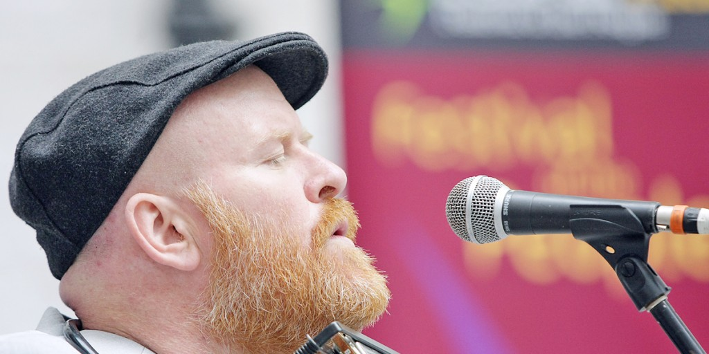 Joby Fox singing at the launch of Féile 2013