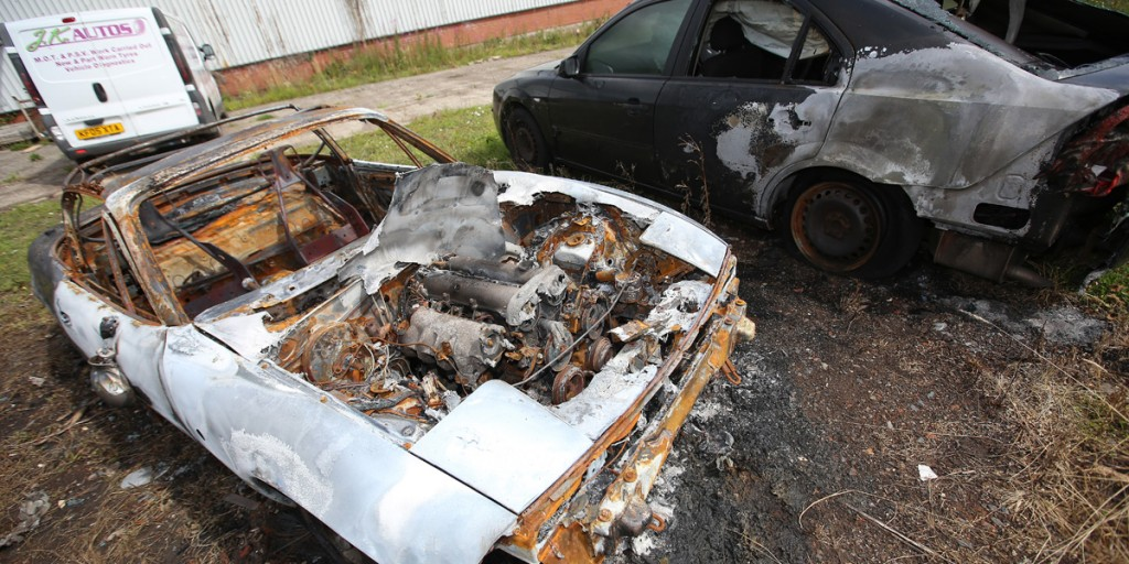 Two of the four vehicles burnt in loyalist attacks at the weekend