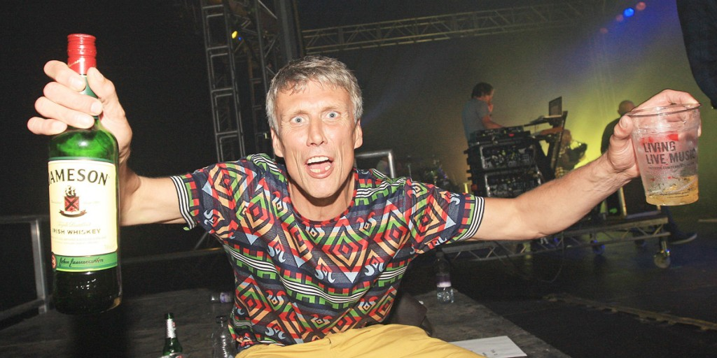 Bez takes a break backstage as the Happy Mondays pump it out in the Big Top