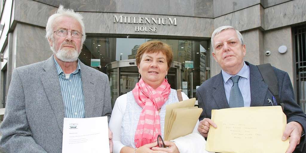 John Crossey, Carmel McCavana and Pat McGrath, lodging planning objection with the Planning Service on the Casement Park development