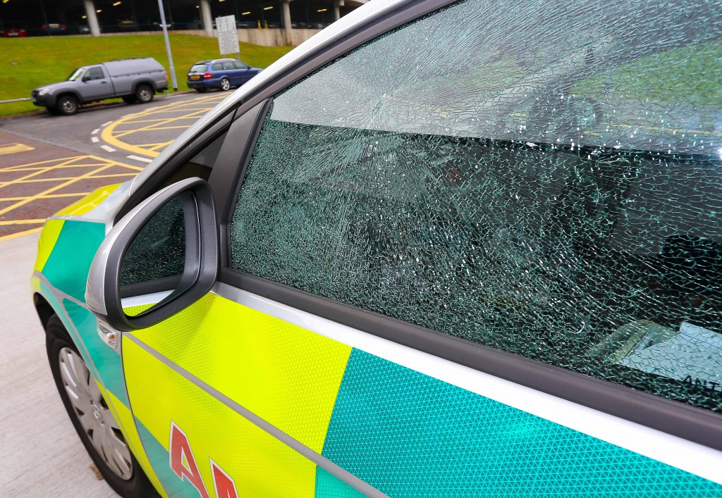 SHATTERED: The ambulance's passenger side window after the attack by street drinkers in the upper Springfield      Pic by Kevin Scott