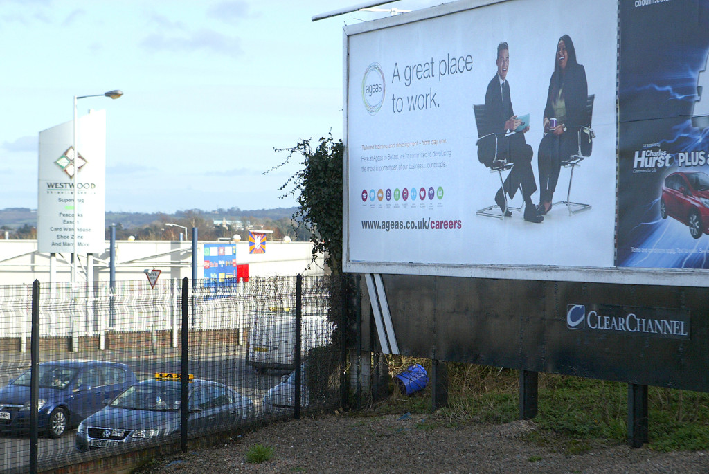 A billboard at the junction of the Andersonstown Road and Kennedy Way advertising careers in Ageas, which is to close its West Belfast operation with the loss of 200 jobs