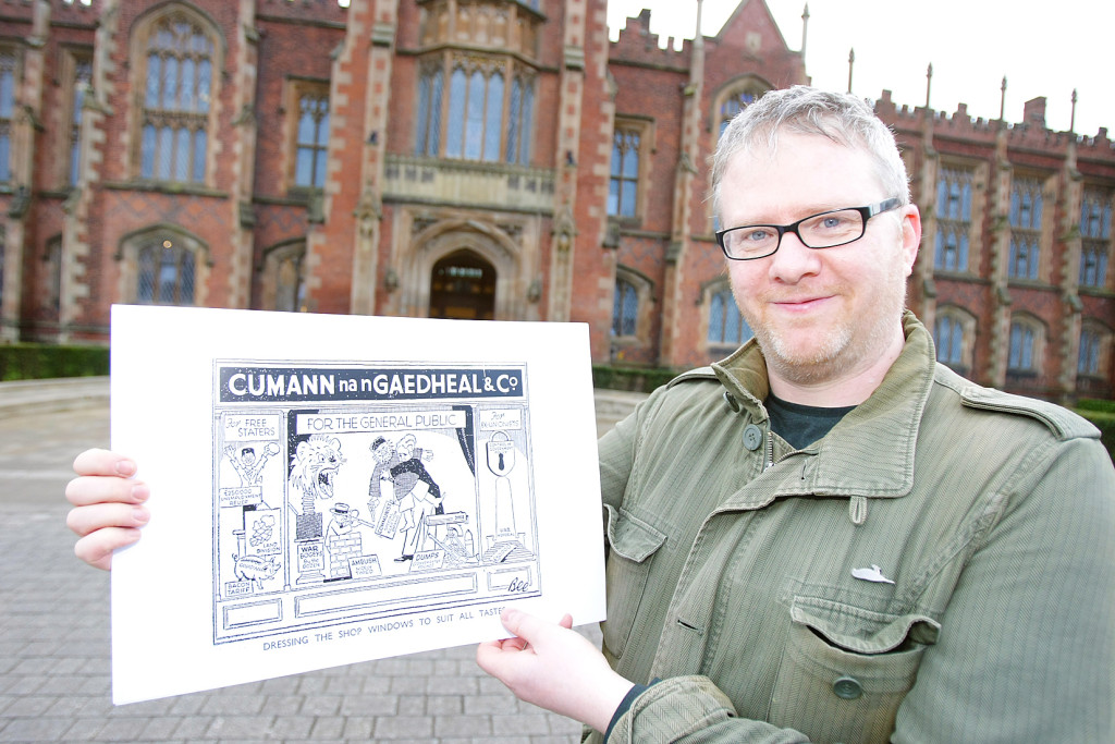 Barry Sheppard with one of the cartoons from his exhibition, which focuses on the economic and political dynamics of 1930s Ireland
