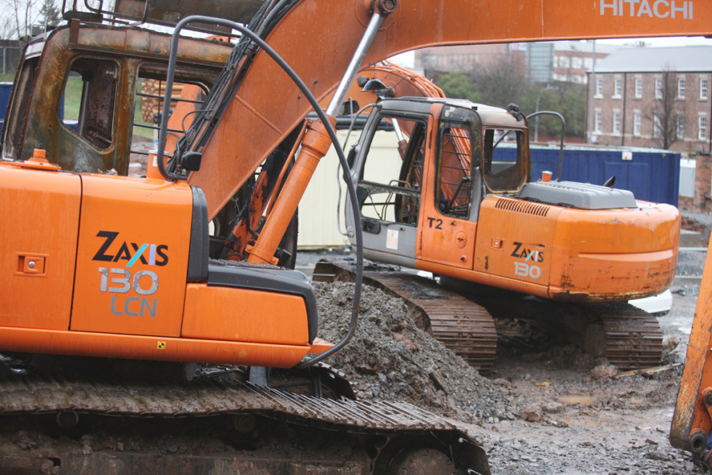 The two earthmovers with their cabs gutted after an arson attack on a building site at the former North Queen Street barracks