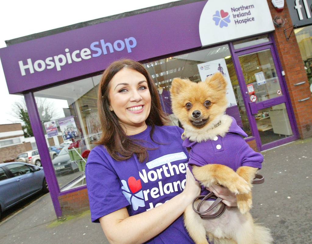 Emma Montgomery at the Finaghy Hospice shop with her Pomeranian Leo, who has put paw to paper to sign up for the Hospice walk