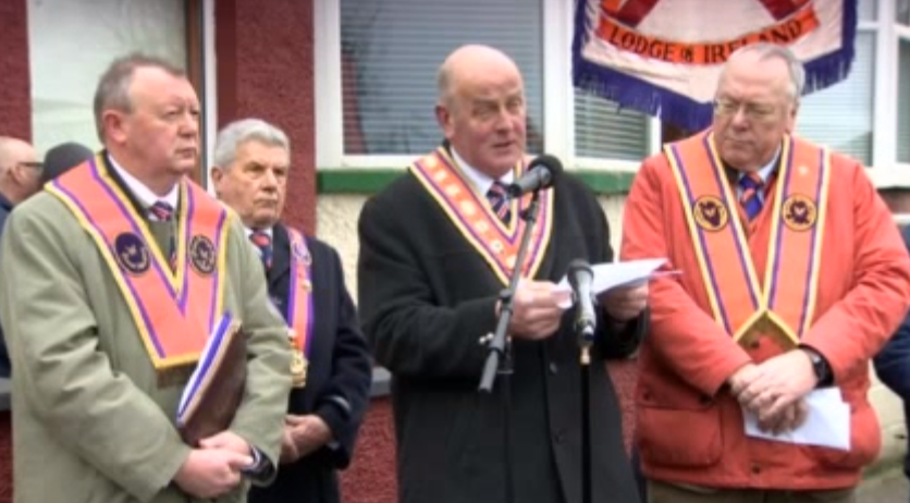 Grand Master Edward Stevenson speaking at Woodvale on Saturday, surrounded by other senior officers of the Orange Order
