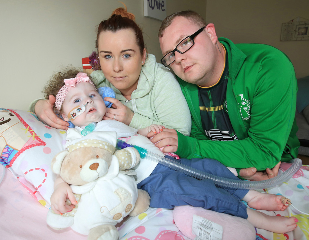 Caoilte Fitzsimons with her parents Robert Fitzsimons and Fiona Murphy. They've been left distraught after an internet troll directed vile abuse at their baby girl