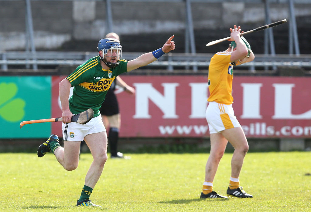 John Egan wheels away in triumph after his late point condemned Antrim to life in Division 2A