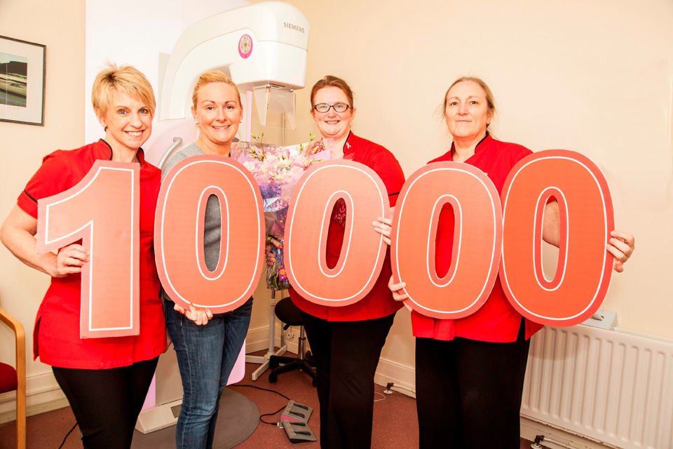 Dunmurry woman Angela Maxwell, second left, is the 10,000th women to be screened for breast cancer by Action Cancer in the 2014/2015 year. With Angela are Action Cancer Radiographers Sharon McCollum, Joanna Currie and Liz Taylor