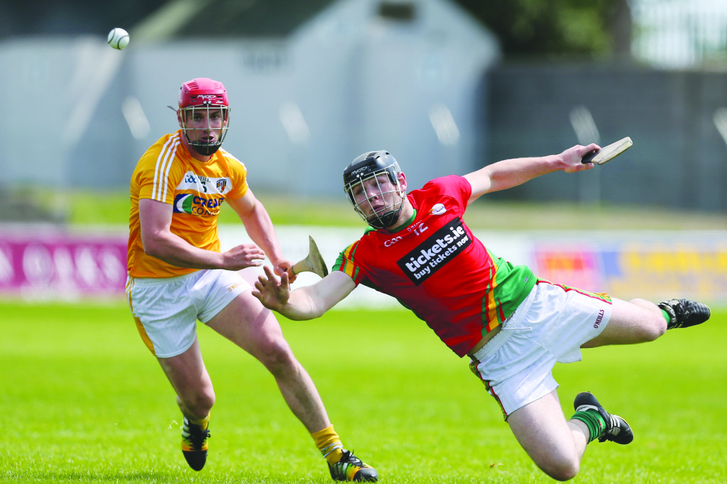 A diving John Michael Nolan of Carlow tries to get his hand to the sliotar ahead of Antrim's Simon McCrory during Sunday's Leinster hurling qualifier at Dr Cullen Park, Carlow