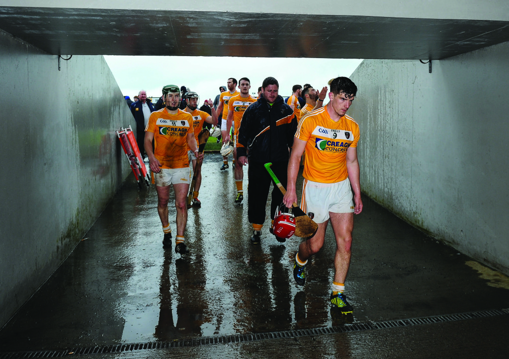 Antrim players trudge off the Cusack Park pitch after their defeat to Westmeath