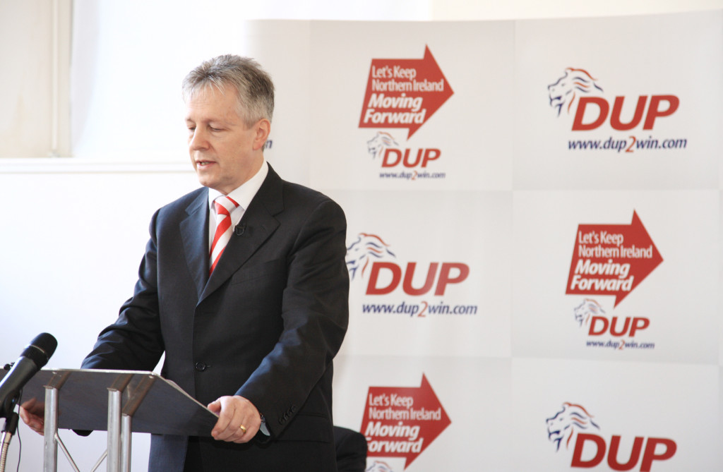 Peter Robinson recovers in hospital from a suspected heart attack