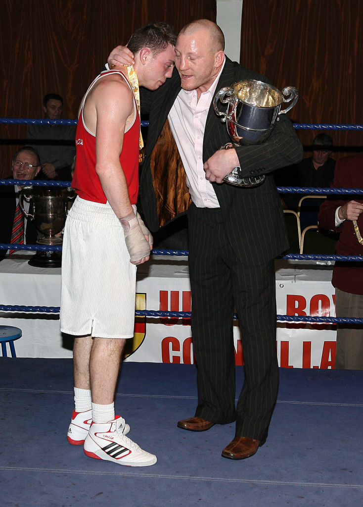 Eamonn Magee Jnr with his dad, Eamonn Snr, after a bout in the Emerald Roadhouse in 2011