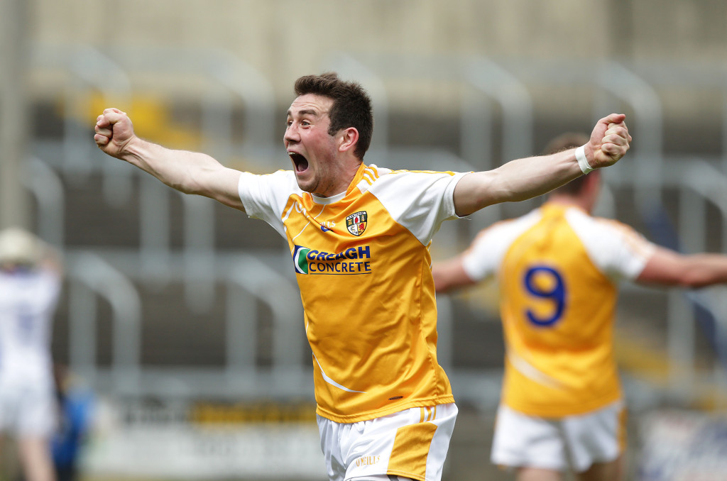 Antrim midfielder Conor Murray can't contain his delight at the final whistle after the Saffrons' epic comeback victory over Laois at O'Moore Park in Portlaoise on Saturday    ©INPHO/Morgan Treacy