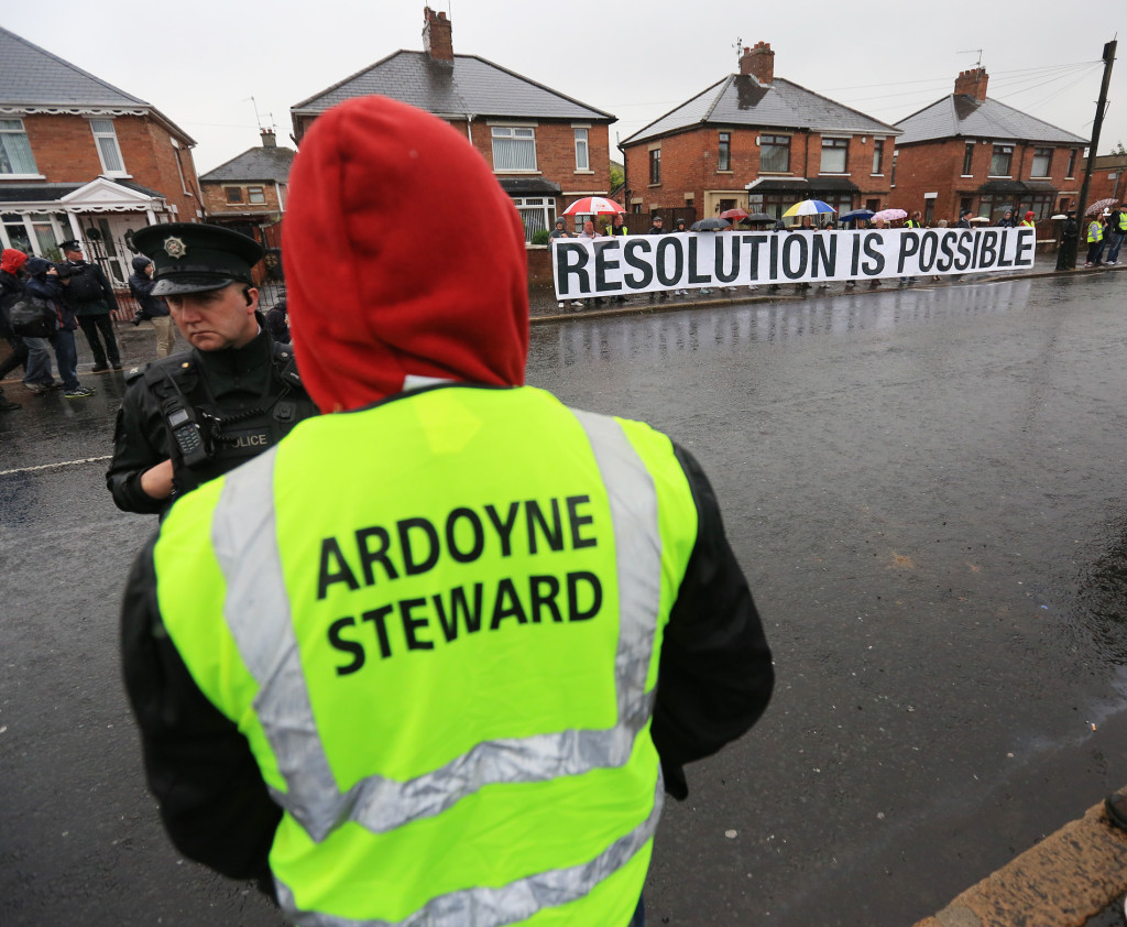 Peaceful protest as Orange bands march past Catholic homes in Ardoyne this morning