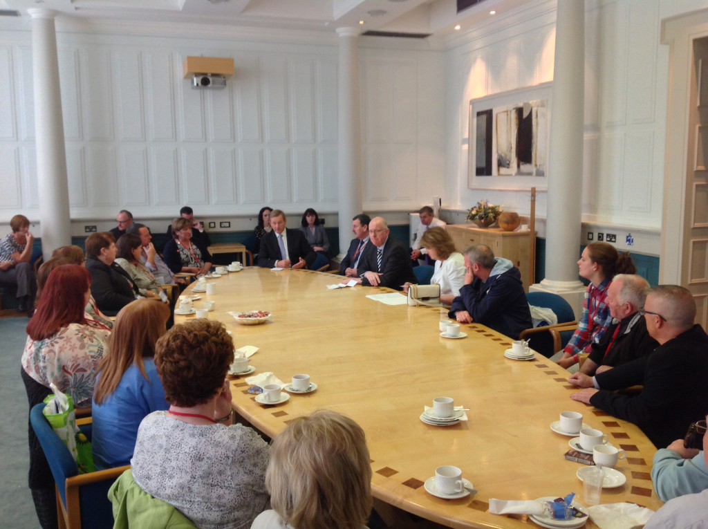 Taoiseach Enda Kenny, Tánaiste Joan Burton and Foreign Affairs Minister Charlie Flanagan around the table with the Ballymurphy families