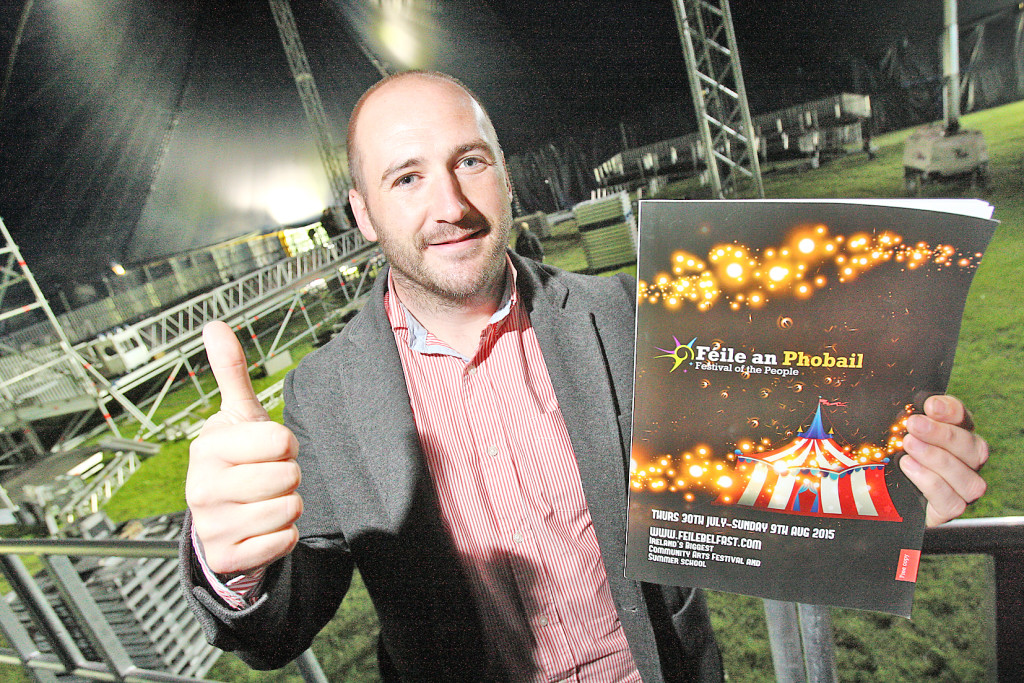 Director of Feile an Phobail, Kevin Gamble, inside the Big Top with his Féile programme