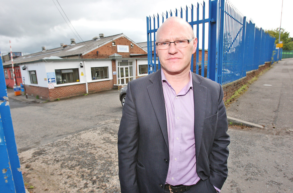 West Belfast MP Paul Maskey at the Initial premises on the Springfield Road, where 24 workers are to lose their jobs
