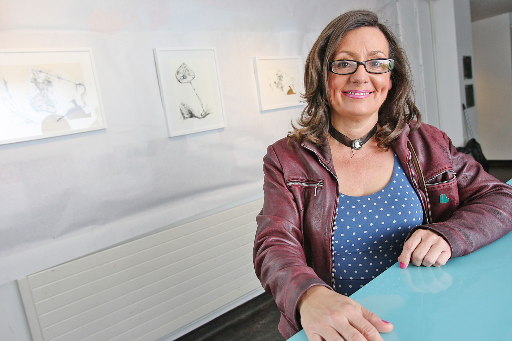 Artist Deirdre Mackel from the Féile Events Group at the exhibition