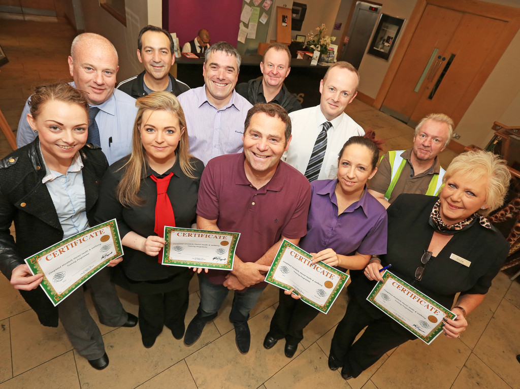 LOOKING OUT FOR OTHERS: ­Phil McTaggart with staff from the Chester and the Lansdowne who completed the vital training