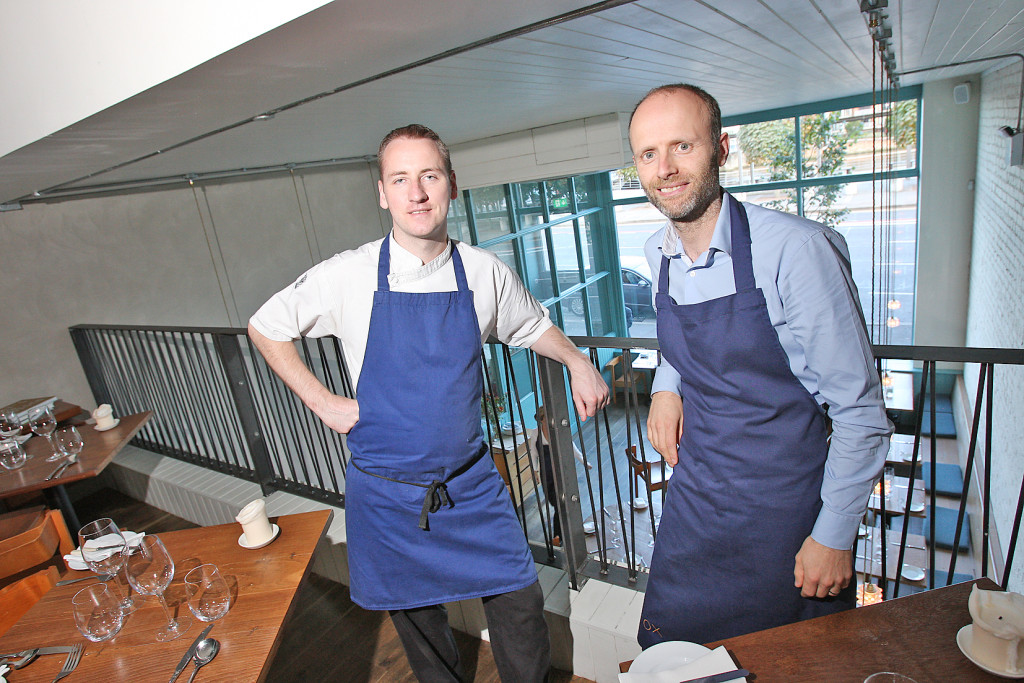 Stephen Toman and Alain Kerloc'h of restaurant OX celebrate winning a coveted Michelin star