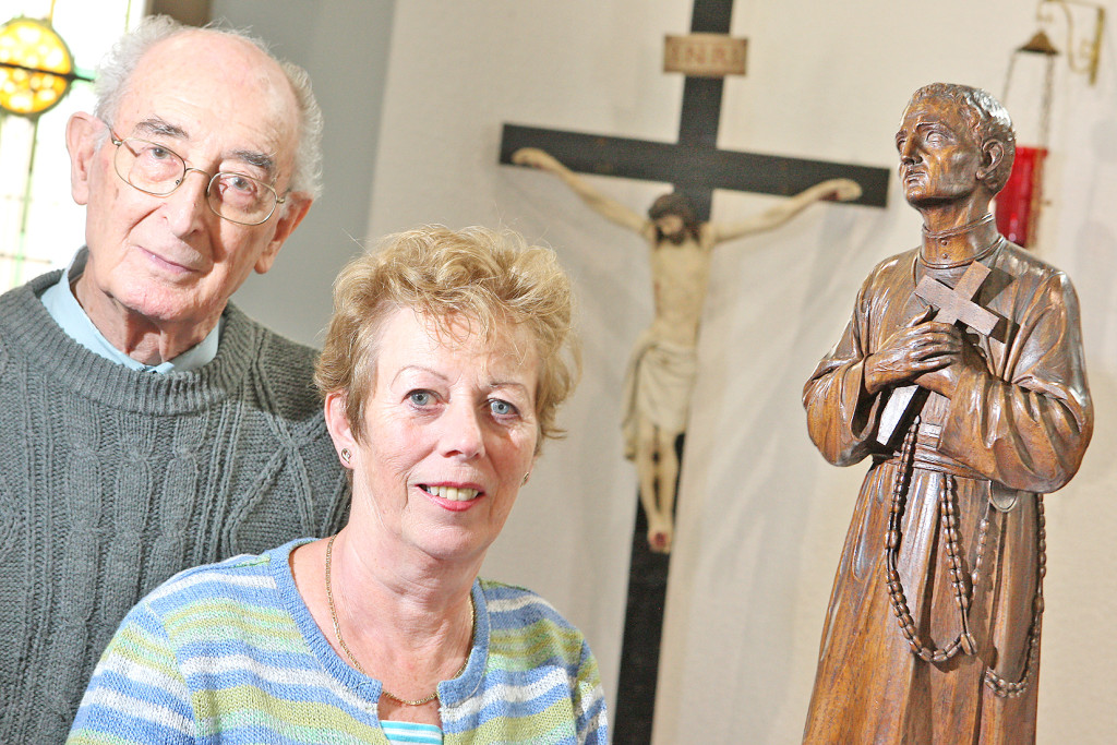 Clonard Redemptorist Fr Sean Moore and Rosemary Doherty beside the beautiful carving of St Gerard Majella, made in Bergen-Belsen