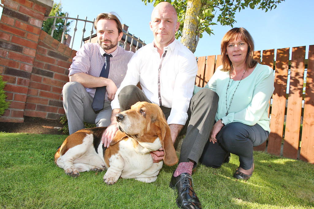 Rossa the Basset hound with his owner Tommy Tolan, centre, Cllr David Bell and Jennifer McCann MLA
