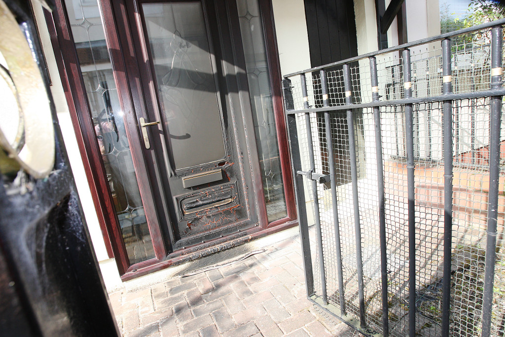 Lighter fuel was poured over the front door of this house in Grosvenor Court and set alight