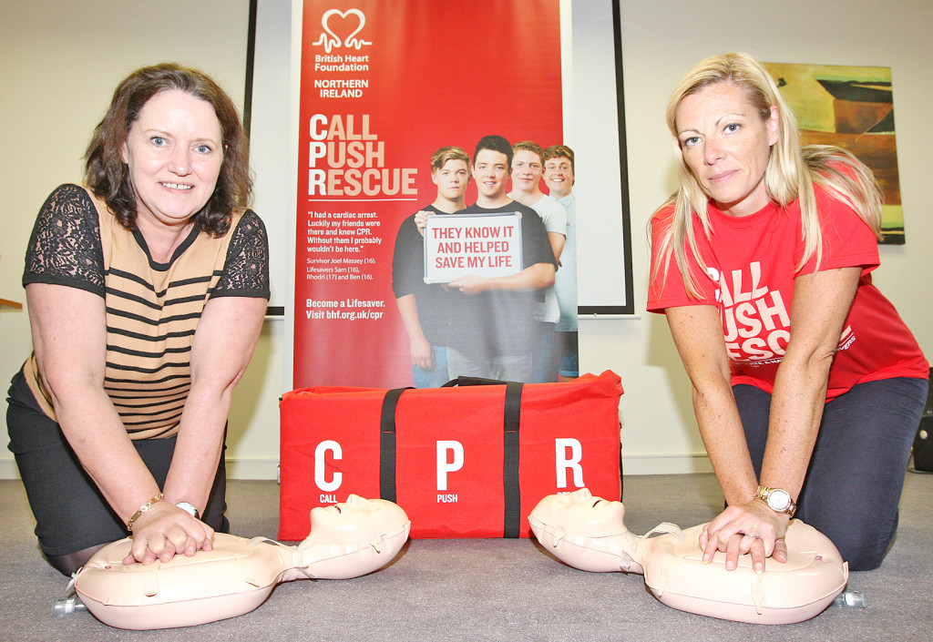Cardiac arrest  survivor Lynda Donaldson with Stephanie Leckey of the British Heart Foundation demonstrating life-saving CPR skills