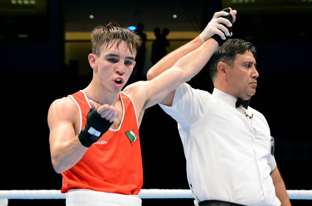 Michael Conlan's hand is raised after he claimed a unanimous points decision against Belarus boxer Dximitry Asanau