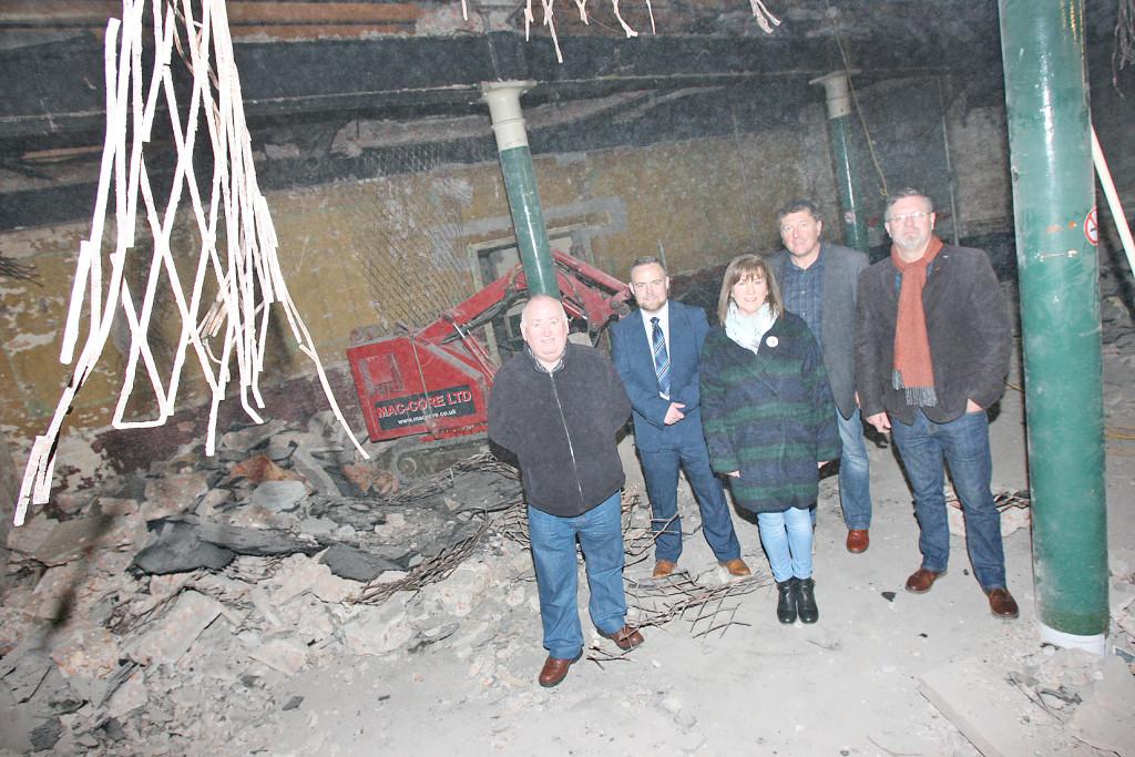 Cumann Cluain Ard's Caoimhín Ó Caitni, second left, with Fra McCann MLA, Rosie McCorley and  Caoimhin Mac Giolla Mhín from Ciste Infheistíochta na Gaeilge and Cllr Jim McVeigh