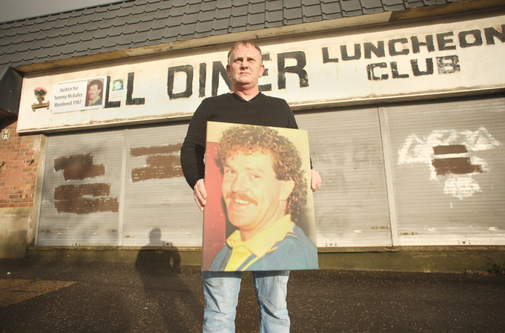 Paul McAuley with a portrait of his brother Thomas at the scene of the 32-year-old's murder in 1987