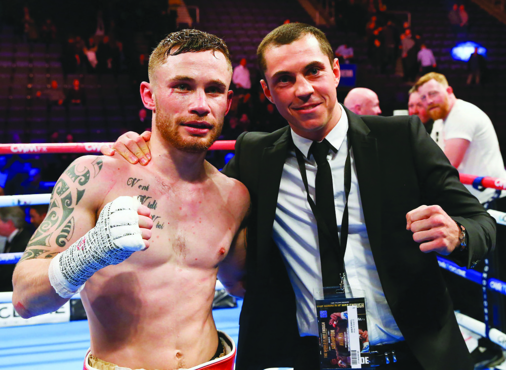 Scott Quigg in the ring with Carl Frampton after the Belfast man's win over Chris Avalos in February – next February both men will be gloved-up