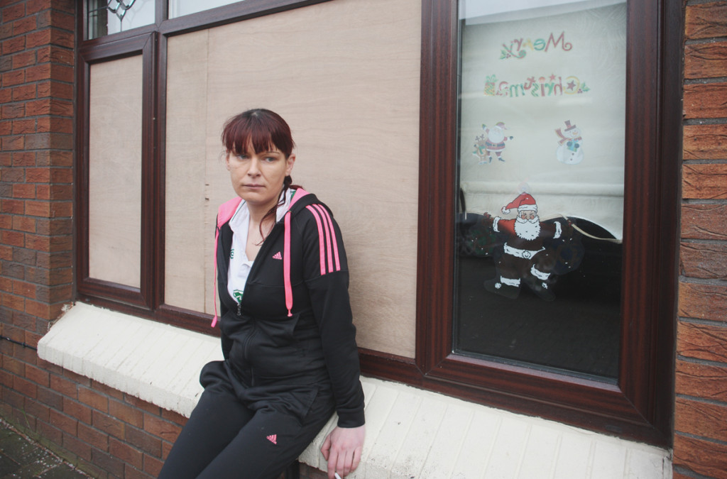 Chantelle Collins outside her Oldpark home where she was threatened by a masked gunman and ordered to leave the area