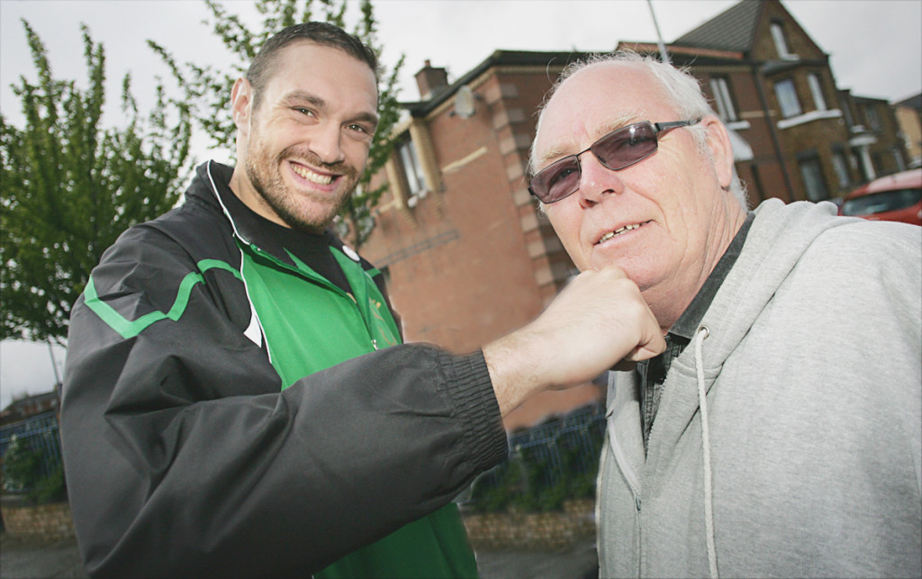 New world heavyweight champion Tyson Fury with Carrick Hill community worker Frank Dempsey during his 2012 visit