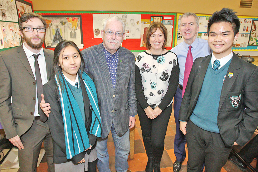 VISIT: Artist Robert Ballagh and South Belfast MLA Máirtín Ó Muilleoir with St Joseph's College pupils Adeleine Salondaguit and John Matthew, teacher Barry McCarroll and classroom assistant Caren Robinson 32711mj15