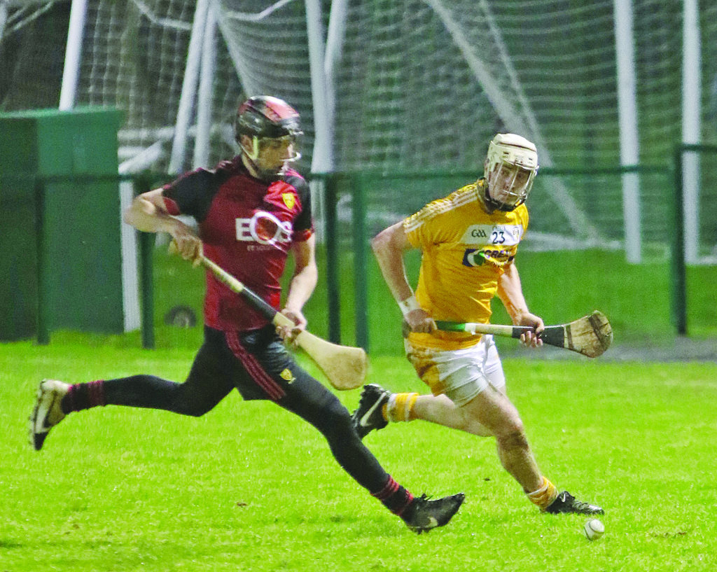 Antrim's Conor McGourty and Down's James Laverty contest possession during Saturday's game at Queen's