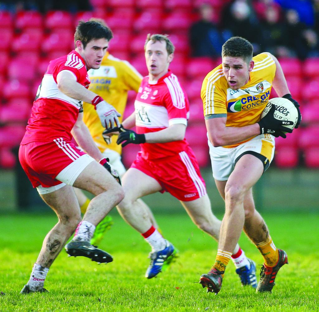Antrim's Jack Dowling evades Derry's Chrissy McKaigue