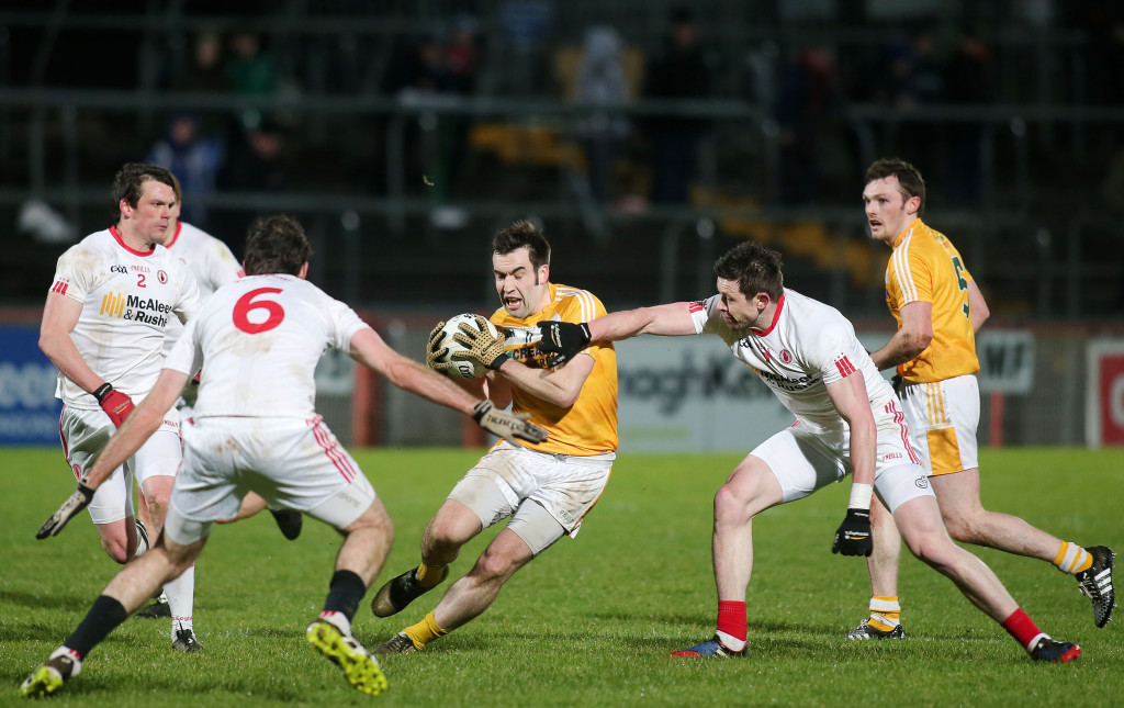 Tyrone pair Justin Mahon and Conor Clarke close the door as Antrim's Kevin Niblick pushes forward at Healy Park last night