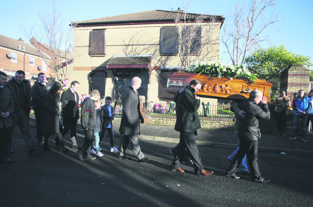 The funeral cortege of Conor McKee passes the Glenpark house where he was shot dead on January 7