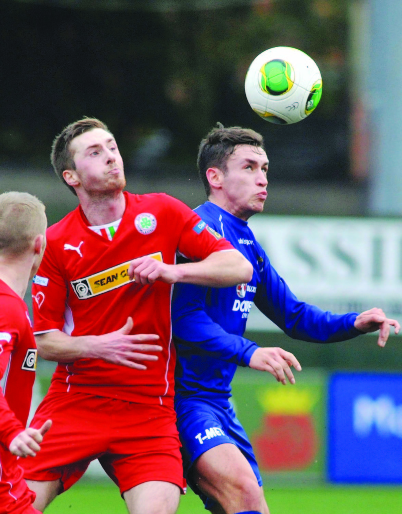 Ciaran Doherty (left), in action for Cliftonville, has signed for Sport and Leisure Swifts and could be in the squad to face Institute