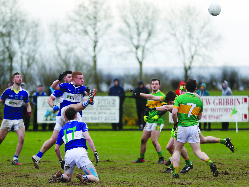 St John's forward Odhran McKenna gets his shot away as Glen captain Ciaran McFaul attempts to block. The Derry side retained the Paddy McLarnon Cup with an eight-point victory at Creggan on Sunday afternoon.