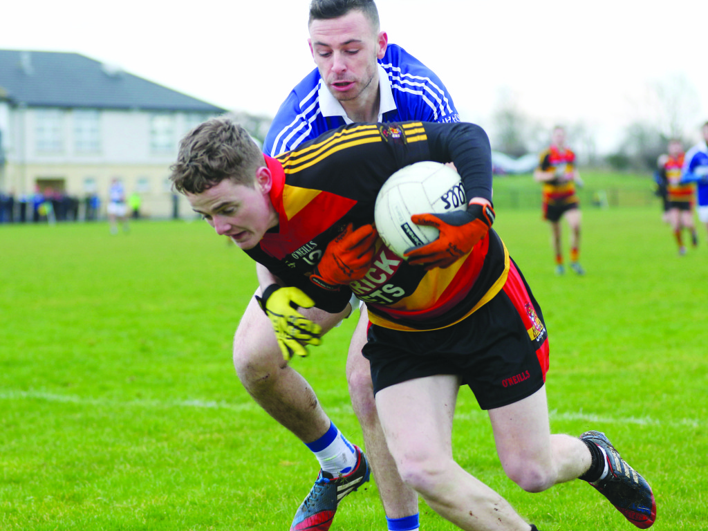 Cullyhana's Francie O'Rourke Cullyhanna comes under pressure from St John's full-forward Matthew Fitzpatrick.