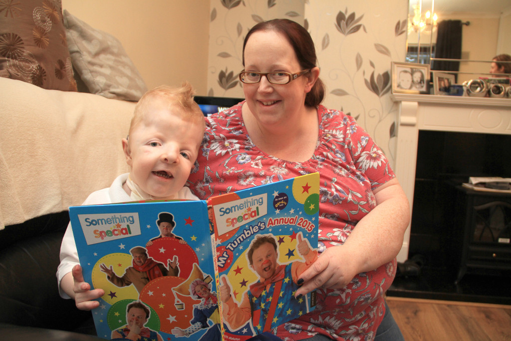 Dáire at home with his mum Colette – she's urging the public to run or walk the Belfast Marathon in aid of Mencap