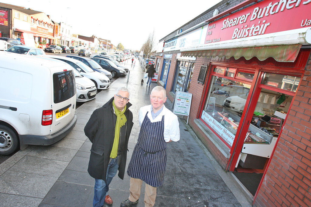 The SDLP's Councillor Tim Attwood with Fintan Shearer of Shearer's Butchers, who fears loss of parking space will hit local businesses