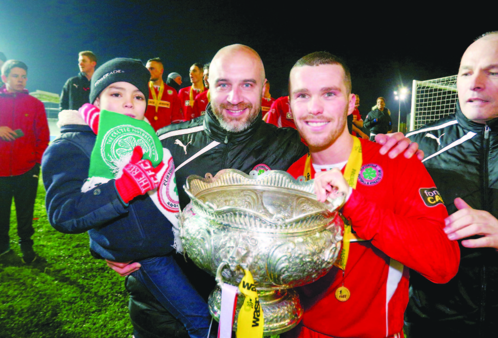 Gerard Lyttle and Martin Donnelly celebrate after last year's League Cup final. Lyttle is hoping to get his hands back on the cup this Saturday as manager of the Reds  Picture - Kevin Scott / Presseye