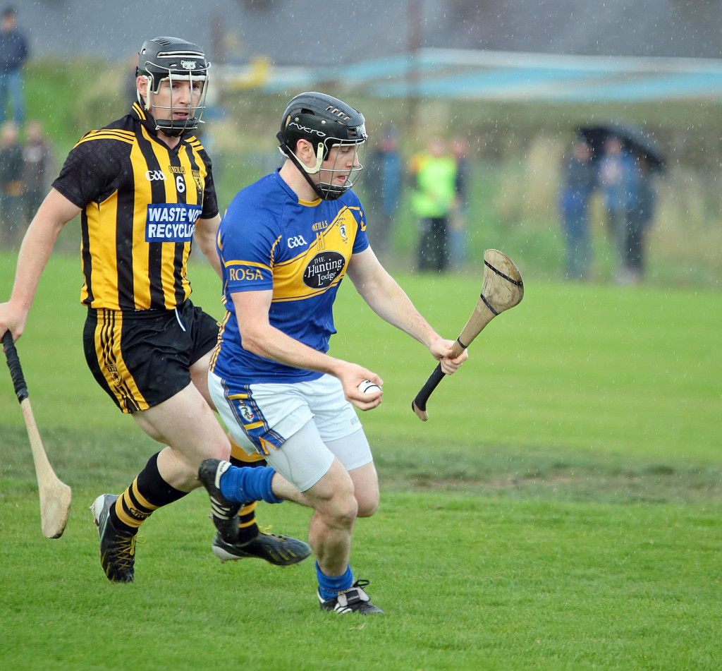 O'Donovan Rossa's Michael Armstrong in action against Neal McAuley of Ballycastle in last year's Antrim SHC. Rossa have been pitted against West Belfast rivals St John's in this year's Championship