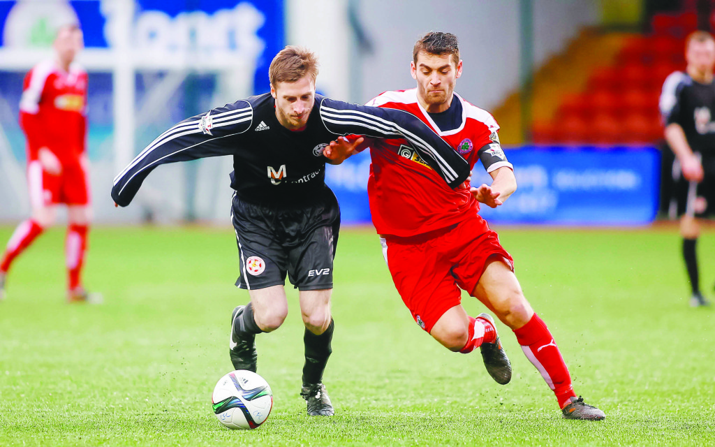 Ciaran Doherty gets away from David McDaid during Saturday's cup tie  Picture - Kevin Scott / Presseye